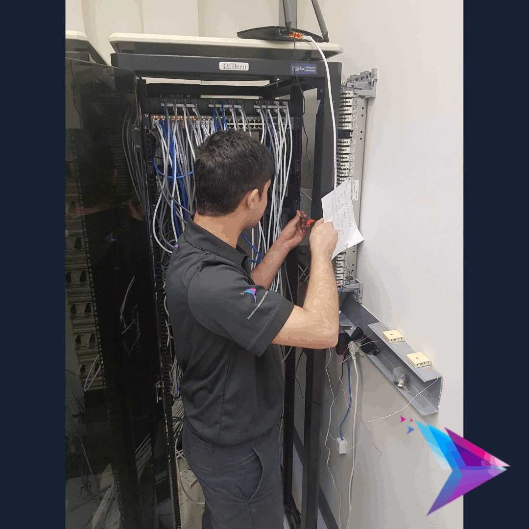 Image of a messy network cabinet starting to get cleaned up.