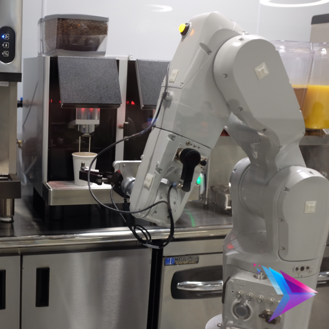 Robot arm making a coffee.
