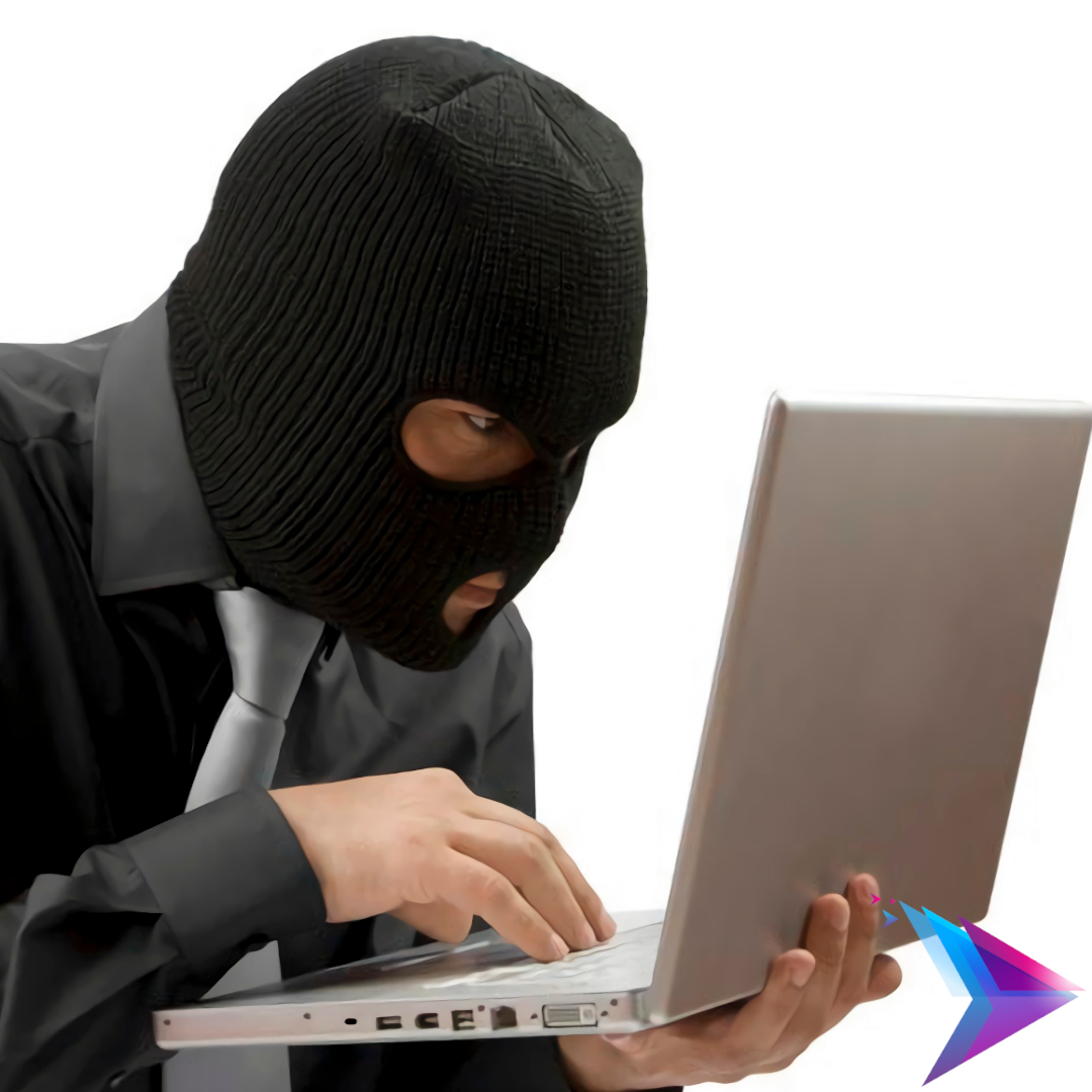 Man in a mask using a laptop.